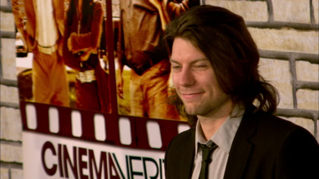 Patrick Fugit posing for paparazzi and moving along the red carpet at Paramount Studios