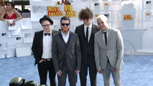 Patrick Stump Andy Hurley Joe Trohman and Pete Wentz of Fall Out Boy at the 2015 MTV Movie Awards at Nokia Theatre LA Live on April 12 2015 in Los...