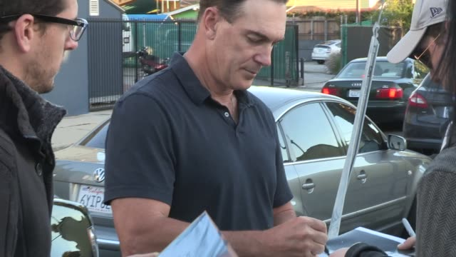 patrick warburton greets fans while arriving to the family guy mobile game launch party in hollywood at celebrity sightings in los angeles on april... - patrick warburton stock videos & royalty-free footage