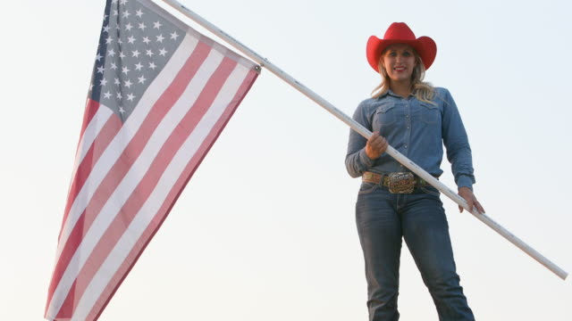 patriotic cowgirl waving an american flag - cowgirl stock videos & royalty-free footage