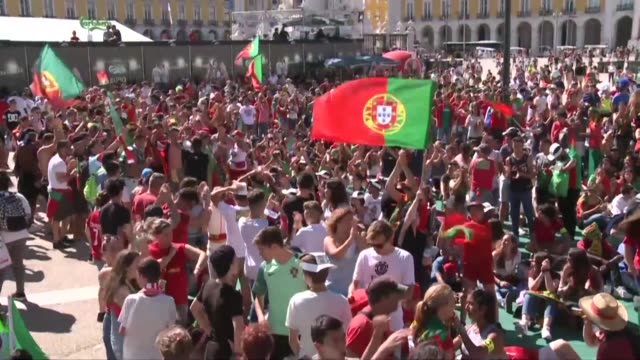 vídeos de stock, filmes e b-roll de patriotic hopes rose sunday in lisbon ahead of the euro 2016 final between hosts france and portugal with supporters of the selecçao hoping to... - euro 2016
