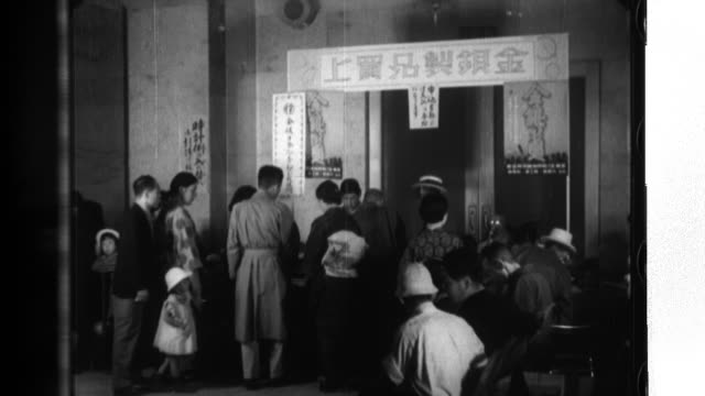 patriotic japanese women surrender their jewelry at a department store where they are paid for the important metals - japanese surrender stock videos & royalty-free footage