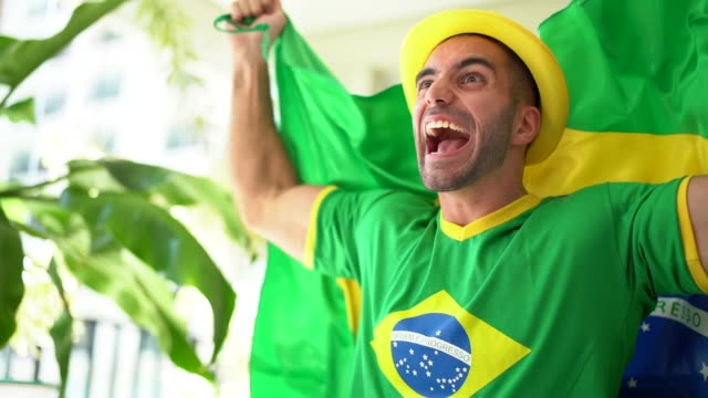 patriotism and celebration of a brazilian young fan - fan enthusiast stock videos and b-roll footage