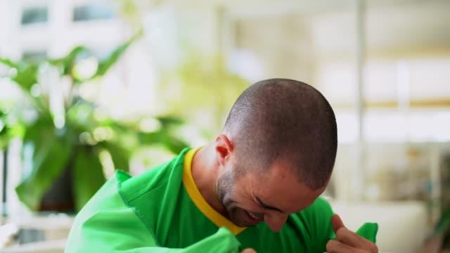 patriotism and celebration of a brazilian young fan - pardo brazilian stock videos & royalty-free footage