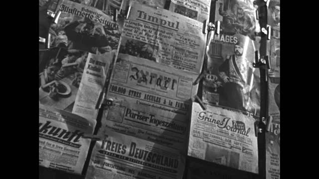 patrons browse newspapers and publications on display at a newsstand in tel aviv / vs newspapers on display in hebrew, german, russian, english,... - reading stock videos & royalty-free footage
