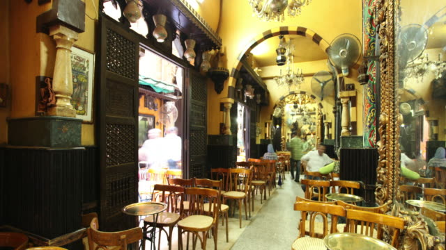 patrons dine at an open air restaurant in cairo. - cairo stock videos & royalty-free footage