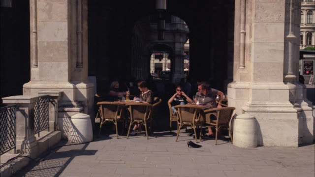 Patrons dine at an outdoor cafe.
