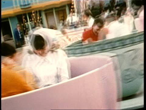 patrons enjoy the teacup ride at a walt disney amusement park - disney stock videos and b-roll footage