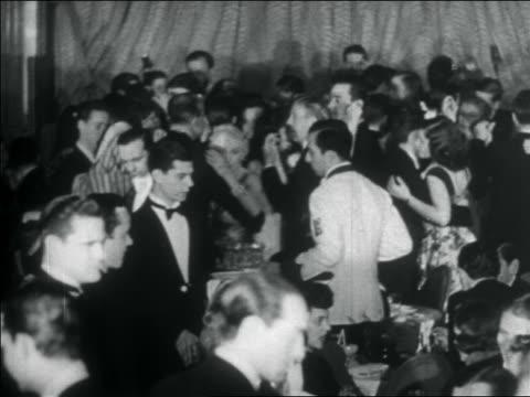 b/w 1938 patrons in formalwear dancing at elegant nightclub / nyc / documentary - 1930 video stock e b–roll