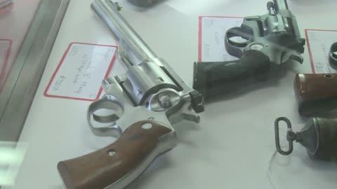 patrons visit a gun shop in kingston, new york. owner makes custom guns - 銃器店点の映像素材/bロール