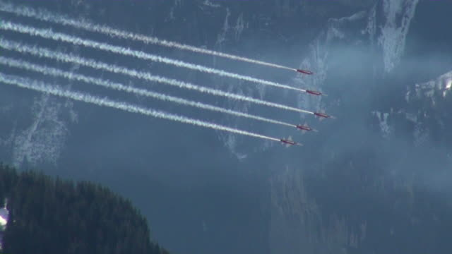 WS POV AERIAL Patrouille suisse hovering in sky at bernese alps  / Wengen, Bernese Oberland, Switzerland