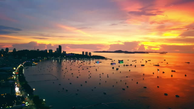pattaya city bay view with golden sunset - pattaya stock videos & royalty-free footage
