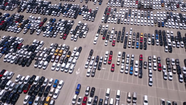 pattern of new cars in a parking lot. drone view - parking stock videos & royalty-free footage