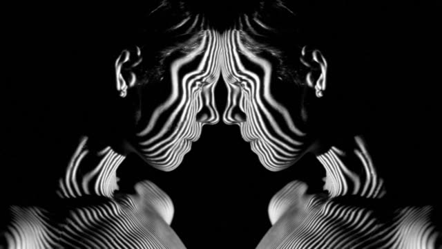 pattern of projector on body and face - art stock videos & royalty-free footage