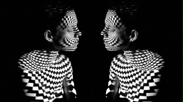 pattern of projector on body and face - surrealism stock videos & royalty-free footage