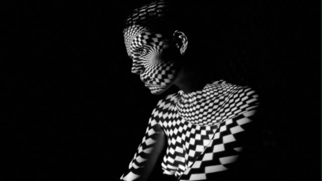 pattern of projector on body and face - film moving image stock videos & royalty-free footage