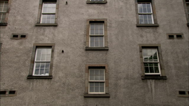 A pattern of windows cover the facade of an apartment building, Edinburgh. Available in HD.