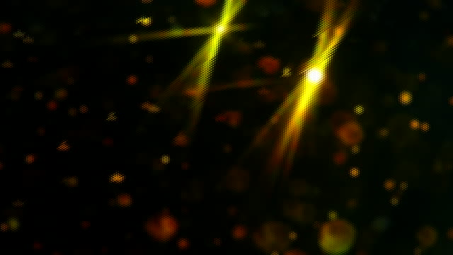 Pattern over abstract golden glitter slowly floating with black background