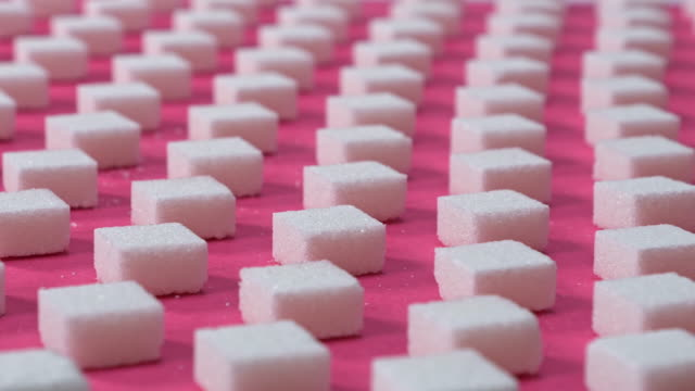pattern sugar cubes on a pink background, panning shot - hot pink stock videos & royalty-free footage