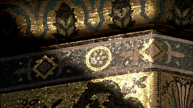 Patterned mosaics cover some of the walls of the Umayyad Mosque Damascus. Available in HD.