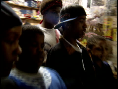 Patterson Projects kids playing Mortal Kombat at a bodega circa late 1990's
