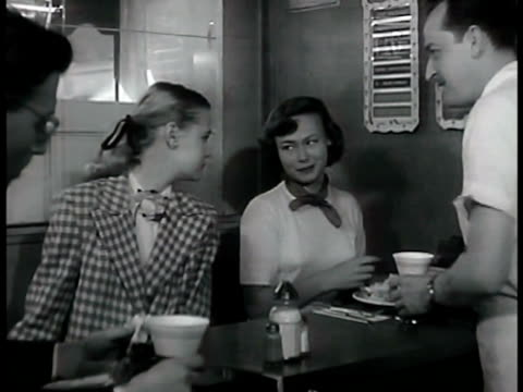 dramatization 'patti' and friend at lunch counter cu salad on plate paper cup in metal holder on diner counter 'patti' eating - dieting stock videos & royalty-free footage
