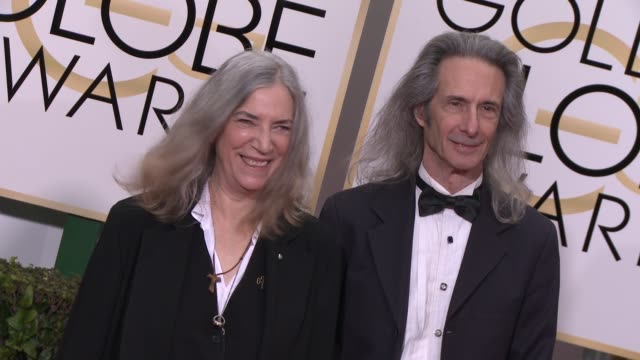 Patti Smith and Lenny Kaye at The Beverly Hilton Hotel on January 11 2015 in Beverly Hills California