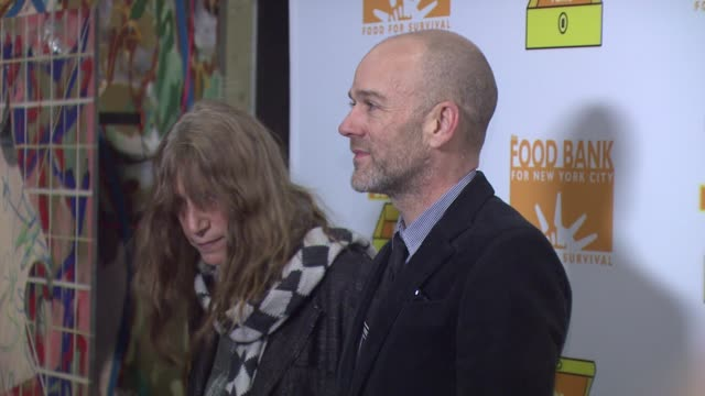 Patti Smith and Michael Stipe at the Celebs Do Lunch Boxes to Help End Hunger at Saatchi Saatchi in New York New York on December 6 2007