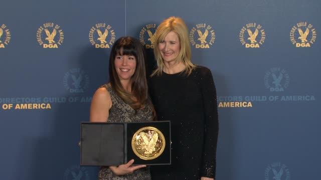 patty jenkins, laura dern at 64th annual dga awards - press room on 1/28/12 in los angeles, ca. - アメリカ監督組合点の映像素材/bロール