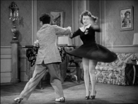 vidéos et rushes de b/w 1946 patty lacey & ray hirsch dancing wildly in living room / short film - rock