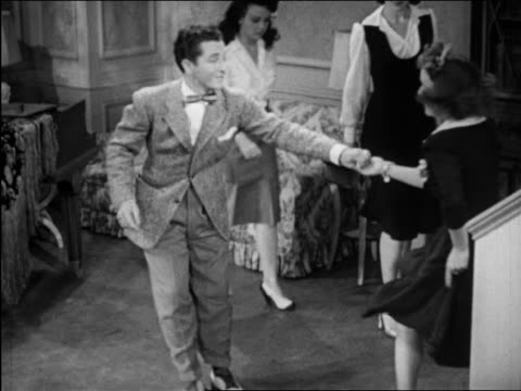 B/W 1946 Patty Lacey & Ray Hirsch dancing with protruding buttocks in living room / short film
