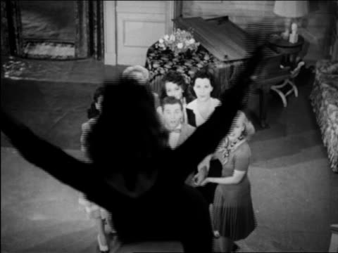 vídeos y material grabado en eventos de stock de b/w 1946 patty lacey sliding down bannister into ray hirsch's arms / other women watch as they spin / film - baranda