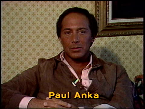 paul anka explains how he changed his looks in order to make it as a teenage heart throb; talks about his songs 'my way', 'put your head on my... - frank sinatra stock videos & royalty-free footage