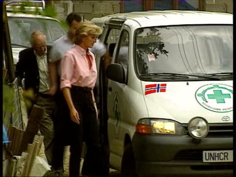 Paul Burrell book backgrounder LIB Diana Princess of Wales out of UNHCR van followed by Paul Burrell during visit to landmine victims