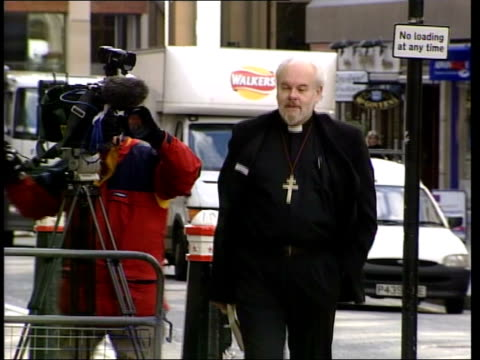 paul burrell court case continues england london bishop of london the rt rev richard chartres towards along street as arriving at court to give... - bishop of london stock videos & royalty-free footage