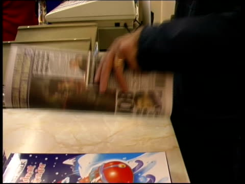stockvideo's en b-roll-footage met paul burrell newspaper revelations itn cheshire copy of daily mirror newspaper on counter with paul burrell's story on front page tilt up man buying... - daily mirror