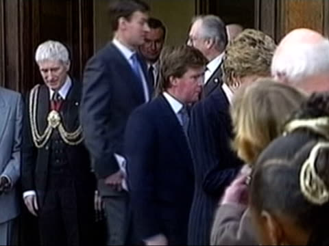 Paul Burrell newspaper revelations LIB Diana Princess of Wales holding bunch of flowers as bodyguard Ken Wharfe along behind LIB Queen receiving...
