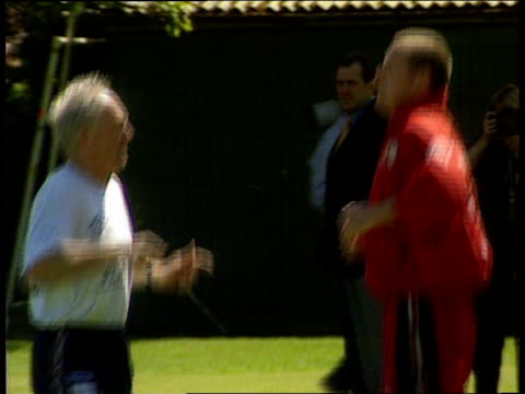 paul gascoigne returns to training itn paul gascoigne running around doing exercises with trainer other england players doing exercises on ground cs... - running shorts stock videos & royalty-free footage