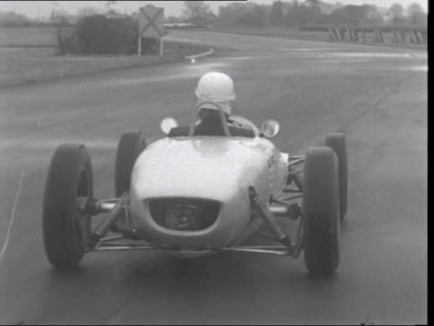 paul getty tries out his new racing car ***also west sussex goodwood racecourse car getty gets into the car puts his helmet on tms j paul getty... - sports helmet stock videos & royalty-free footage
