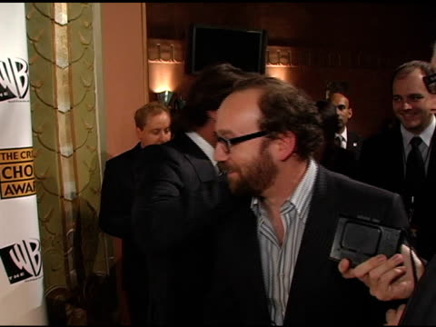 Paul Giamatti greeted by Tim Robbins and Javier Bardem at the 2005 Critics' Choice Awards Interviews at the Wiltern Theater in Los Angeles California...