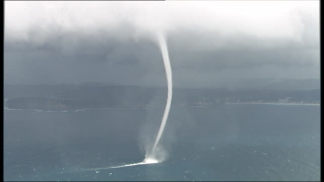paul kadak reports on three monster waterspouts formed off the north coast from sydney: helicopter aerials waterspout tornado twister off avoca... - bagnato stock-videos und b-roll-filmmaterial