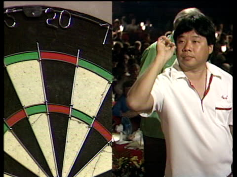 paul lim scores 180 with first three darts of famous leg where he became first player to complete nine dart finish at world darts championship... - world championship stock videos & royalty-free footage