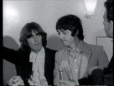 paul mccartney and george harrison of the beatles are interviewed with someone dressed up as a cartoon character from their latest animation film... - paul mccartney stock videos and b-roll footage