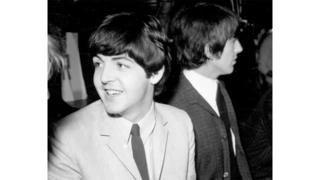 """paul mccartney and george harrison of the rock and roll band """"the beatles"""" pose for a portrait during a press conference backstage at their concert... - paul mccartney stock videos & royalty-free footage"""