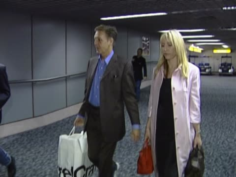 paul mccartney and girlfriend heather mills arrive at heathrow from new york in one of the first shots of them together walk through the terminal and... - paul mccartney stock videos and b-roll footage