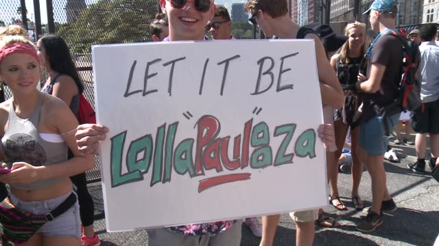 paul mccartney fans at lollapalooza music festival in chicago on july 31, 2015. - festival goer stock videos & royalty-free footage