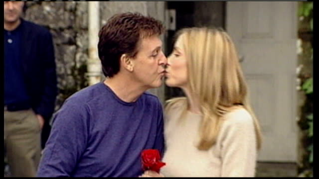 paul mccartney marries nancy shevell; r10060202 republic of ireland: glaslough: castle leslie: mccartney kissing second wife heather mills before... - celebrities video stock e b–roll