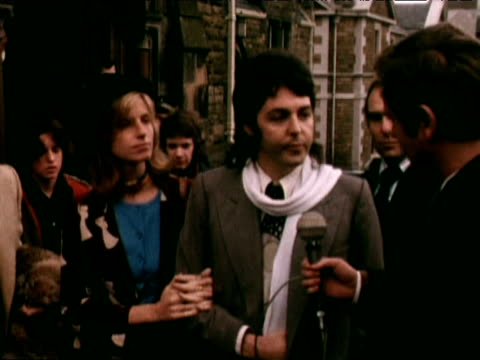 paul mccartney stands beside wife linda outside court having been fined for growing cannabis plant; 1973 - paul mccartney stock videos & royalty-free footage