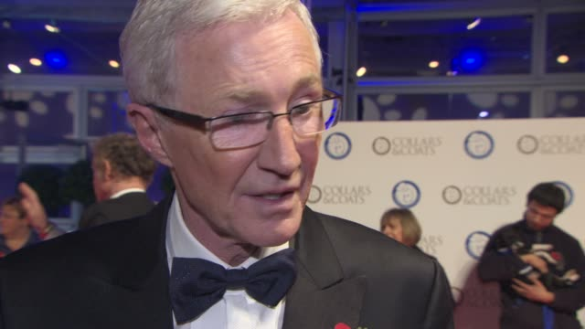 stockvideo's en b-roll-footage met interview paul o'grady on his dogs filming in africa his charity work at collars coats gala ball on october 30 2014 in london england - paul o'grady