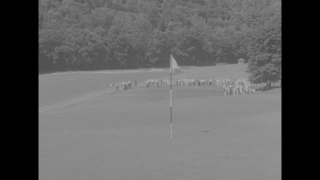 paul runyan tees off during pga championship match at the shawnee inn and golf resort / sam snead tees off / gallery walks on course / gallery... - pga stock videos & royalty-free footage